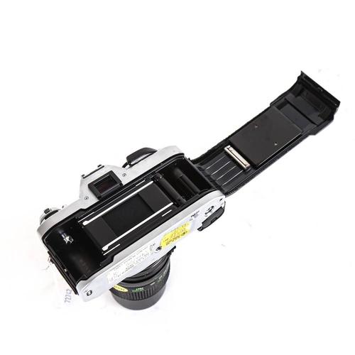 58 - CANON - a Vintage AL-1 35mm single lens reflex camera, with Vivitar 135mm 1:2.8 lens and Skylight 52...