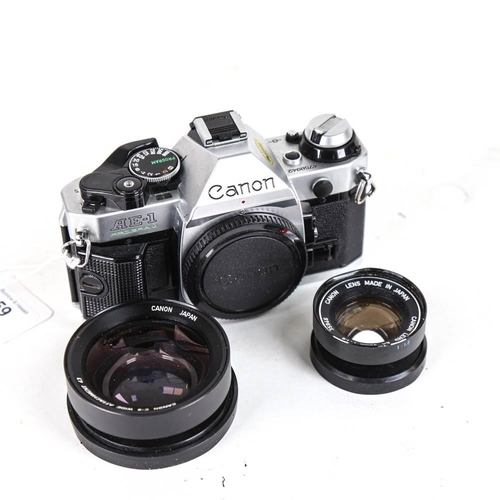 59 - CANON - a Vintage AE-1 Program 35mm single lens reflex camera, with Canon 50mm 1:1.8 lens and Canon ...