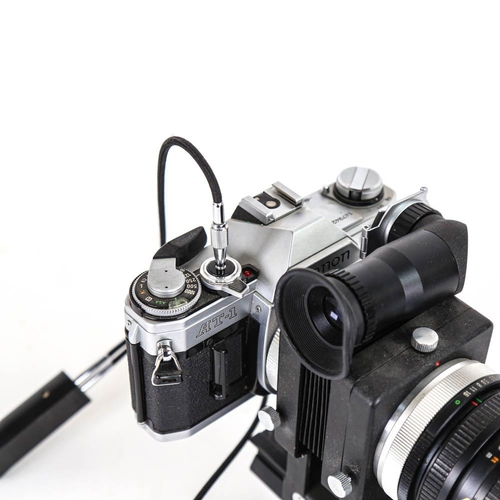 60 - CANON - a Vintage AT-1 35mm single lens reflex camera, with Unitor bellows slide duplicater