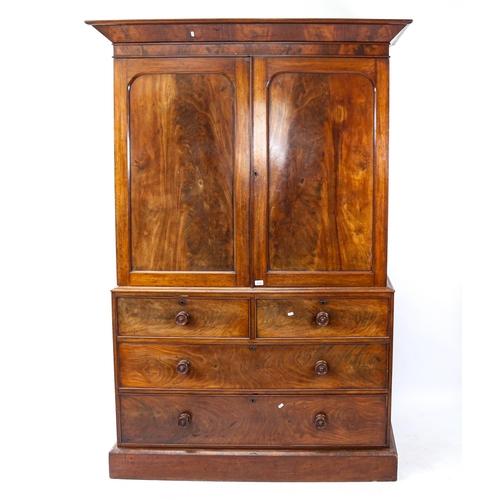 A 19th century flame veneered mahogany linen press, W145cm, H212cm, D55cm