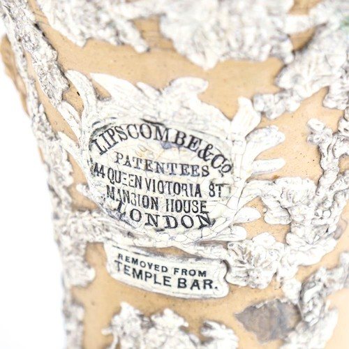 32 - A Victorian Lipscombe & Co stoneware water filter, with coat of arms, applied decoration and inscrib...