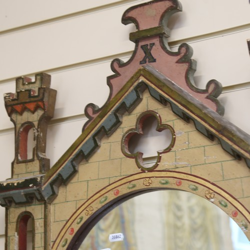 45 - A decorative painted wall mirror, modelled as an entrance to a castle, height 80cm