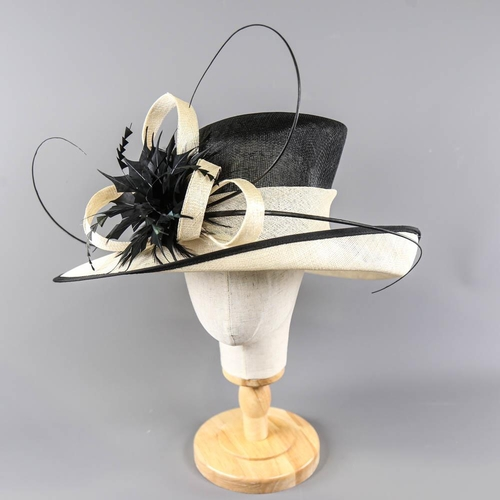 Black and ivory occasion hat, with feather and twirl detail, internal circumference 55cm, brim width 13.5cm, height 16cm