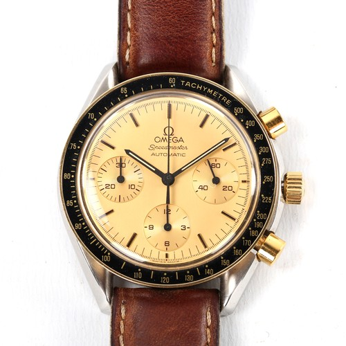 OMEGA - a bi-metal Speedmaster Reduced automatic chronograph wristwatch, ref. 175.0032, circa 1990, champagne dial with gilt baton hour markers, 3 subsidiary dials and gold tachymetre bezel, 46 jewel movement with calibre 1140, printed caseback no. 51601380, case width 39mm, working order, boxed with papers