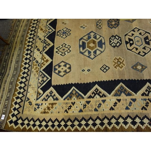 17 - Antique Shiraz rug 10'6 long x 5'6 wide, blue and cream, tassel boarder to top and bottom, strong co...