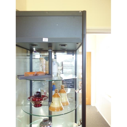 23 - 6' 6 tall shops display cabinet with 4 glass circular shelves enclosed highlighted by spot lights, a...