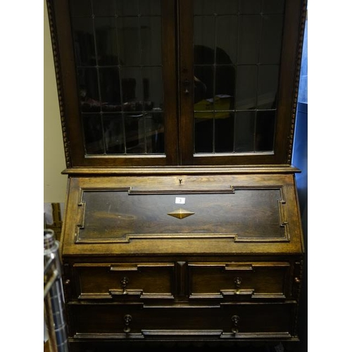 3 - 1920's Jacobean inspired Bureau Bookcase with barley twist raised support, containing a Bureau fall ...