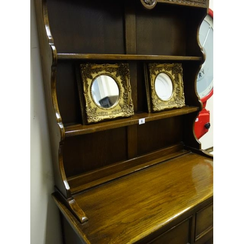 6 - Good quality oak antique style dresser 6'6 tall with carved decoration throughout, the base unit con...