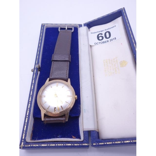 60 - Gents 9ct GOLD vintage Garrard watch, with original box, previous owner presentation engraving to ba...