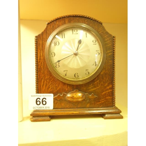 66 - Miniature 1920's bracket style clock in an oak case with silvered dial 8 day movement dial marked Ma...