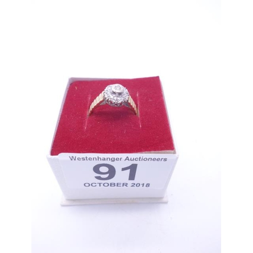 91 - Ladies 18ct GOLD ring the top set with a small diamond size L, 3.7 grams...