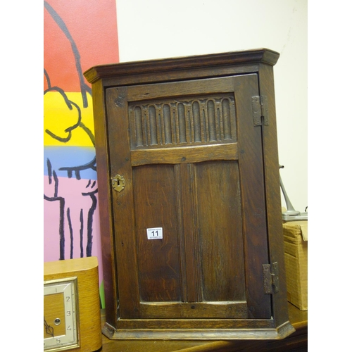 11 - Antique style corner cupboard, the door opening to reveal a single shelf, 24