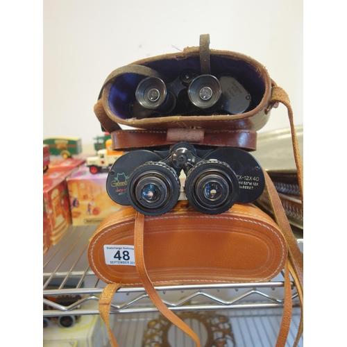 48 - Pair of green cat zoom 7 x 12 x 40 binoculars with carrying case, 1 other set of binoculars Dienstgl...