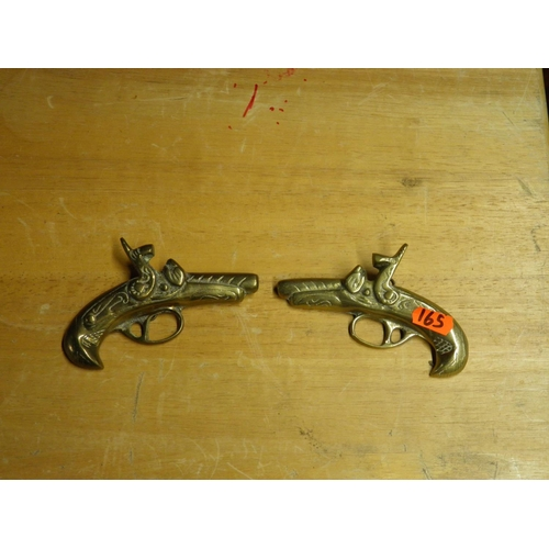 133 - Two small brass pistols...