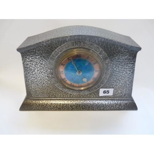 65 - A Liberty & Co Tudric Pewter and enamel mantel clock, model no.01156, hammered finish, cast in low r...