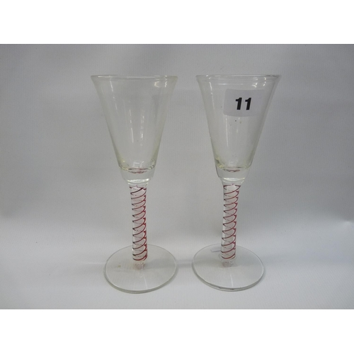 11 - Pair of Georgian cordial glasses with conical-shaped bowl, opaque and ruby glass stem on splayed foo...