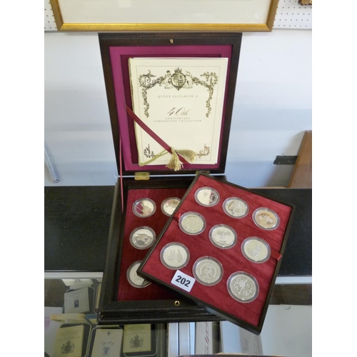 202 - Cased Queen Elizabeth II 40th Silver Anniversary Coin collection comprising of 18 Silver Crowns...