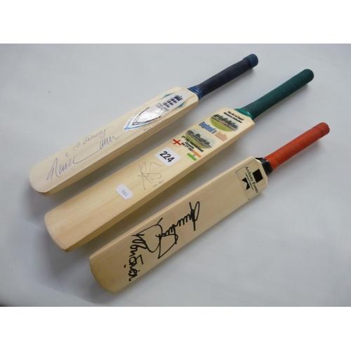 224 - 3 Miniature Souvenir cricket bats signed by Ian Bell, Phil Tufnell etc...