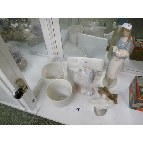 23 - Collection of Lladro to include two cabinet plaques, Woman with Lamb, Duck, Camel and 2 unglazed pot...