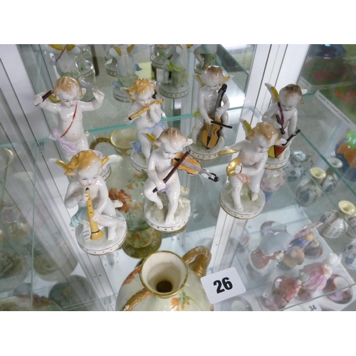 26 - Set of Seven Sitzendorf early 20thC Musical Cherubs with underglaze marks to base, 9cm in Height...