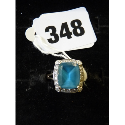 348 - Ladies 18ct White Gold Cushion cut Aquamarine in claw setting surrounded by milligrain set Diamonds,...