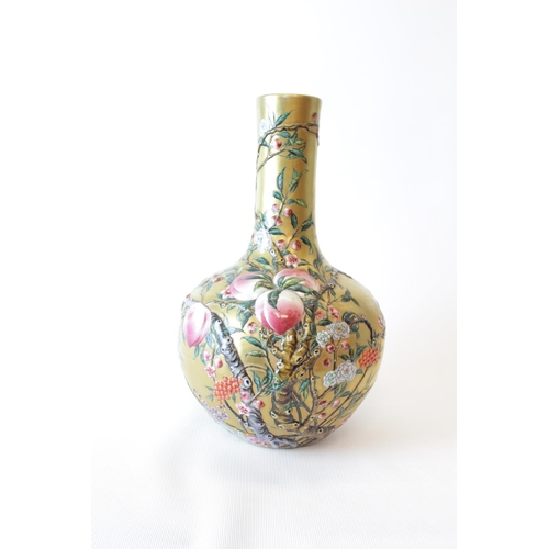 2 - Fine Chinese Tianqiuping nine Peaches foliate decorated vase with bright gilded ground, Qianlong sea...