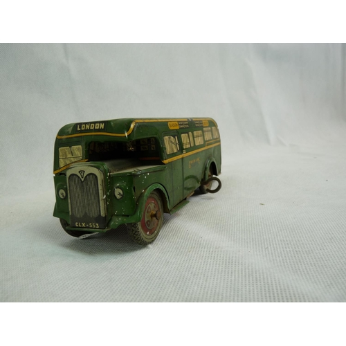 221 - A Wells Brim Toy tin plate and clockwork Green Line bus comprising dark green with yellow trim, tin ...