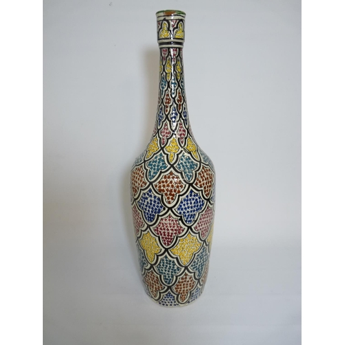 50 - Morrocan Safi multi coloured vase of long narrow neck, signed mark to base. 49cm in Height...