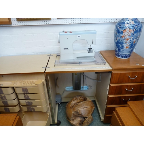 51 - Elna of Switzland Sewing machine in Horn Collection Cabinet with Accessories and pamphlets...