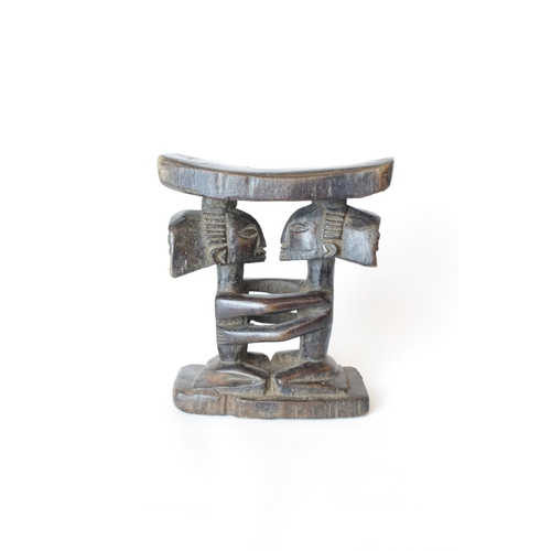 7 - Rare Ghanaian Childs Ashanti Stool/Headrest with warrior decoration. 19cm in Height...