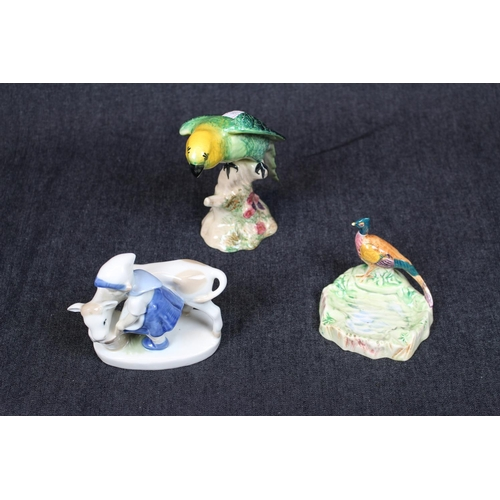 20 - Beswick Parakeet 930, Beswick Pheasant soap dish and a Dutch figure of a Girl with Cow...
