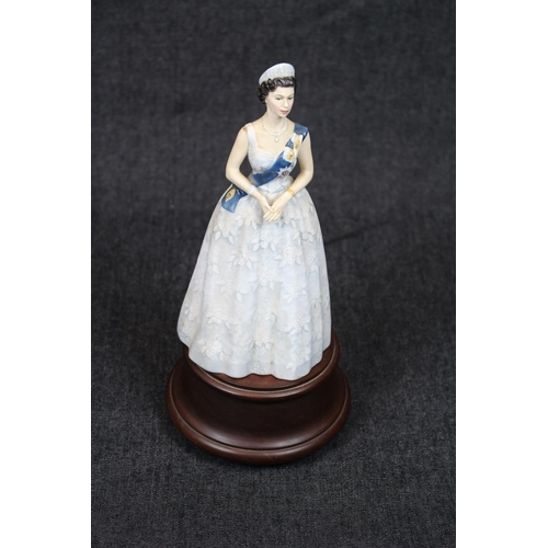 21 - Royal Doulton Limited Edition 20th Anniversary Queen Elizabeth II 1953-73 HN 2502 No.7 on wooden bas...