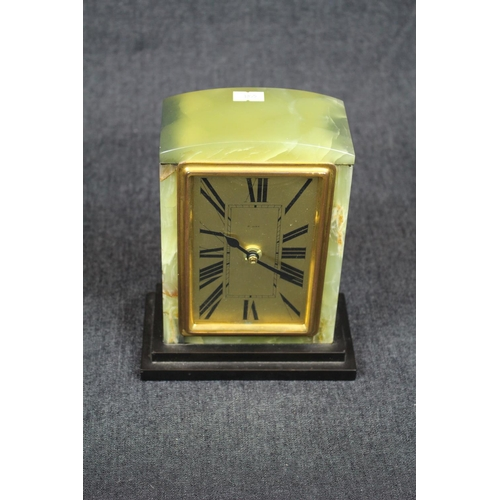 25 - Art Deco French Onyx cased mantel clock with gilded Roman numeral dial, supported on Slate base, lat...