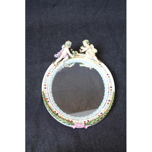 29 - Good Quality Sitzendorf Oval wall mirror with surmounted Cherub decoration, beaded and floral frame,...