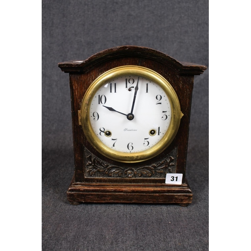 31 - Edwardian Sessions mantel clock with numeral dial, brass bezel and carved foliate case, 29cm in heig...