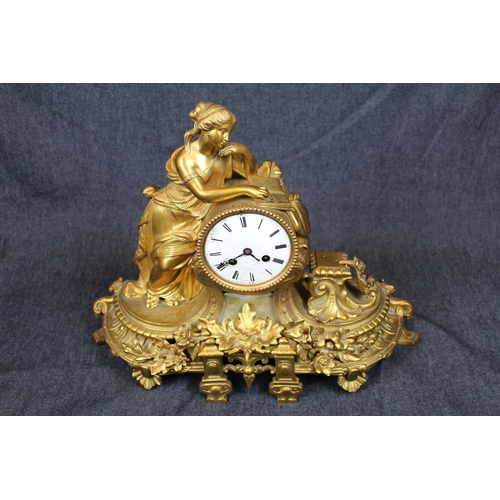 38 - Impressive Victorian Gilded Brass figural decorated mantel clock with roman numeral dial marked Bouv...