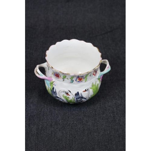 4 - Good Quality European Porcelain two handled Jardiniere with Swan and Flora decoration on basket desi...