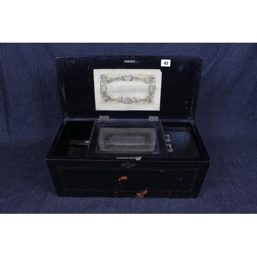 42 - Late 19thC Swiss Music Box of 8 Airs with paper to interior, Walnut inlaid case, 49cm in Length. Con...