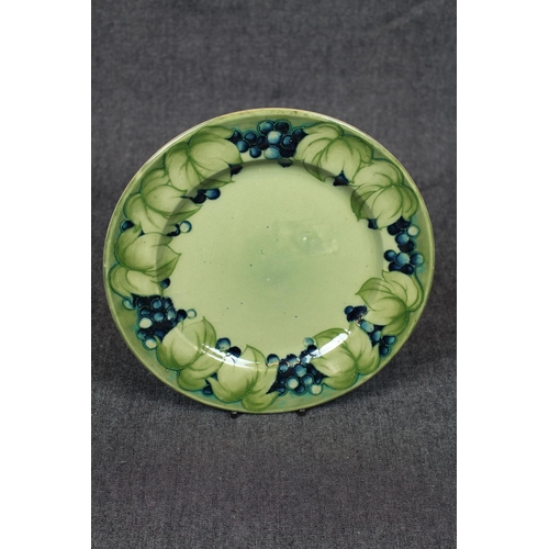 7 - Rare Moorcroft Celadon Leaf and Berry design plate of green ground design and signed by William Moor...