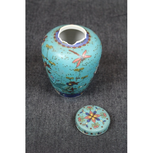8 - 19thC Chinese Lidded Jar decorated with Butterflies and flora with blue ground base, Under glaze Eig...