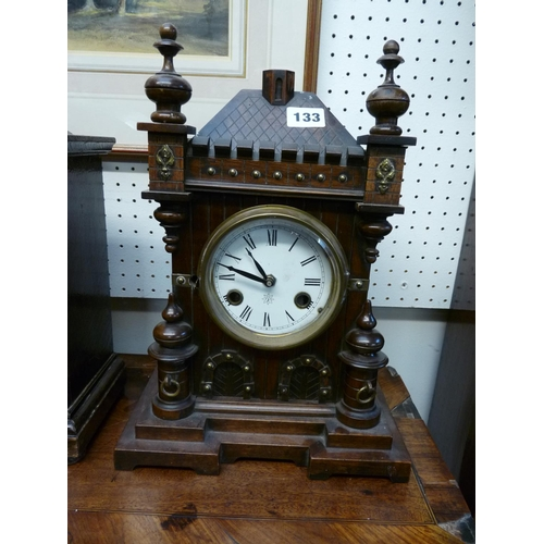 133 - Jughans Walnut cased mantel clock with roman numeral dial...
