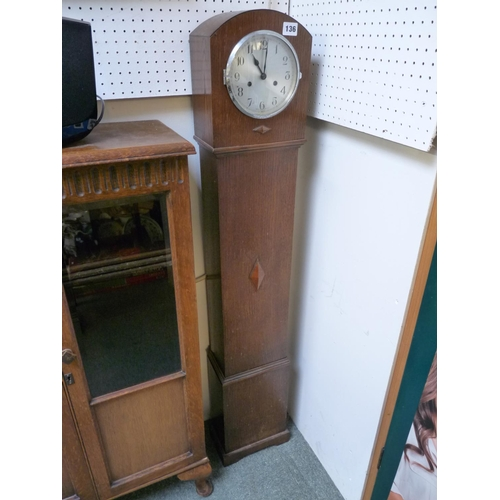 136 - Oak Cased Grand daughter clock with numeral dial...