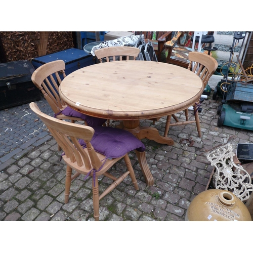 4 - Pine circular table on tripod base and a set of 4 Pine dining chairs...