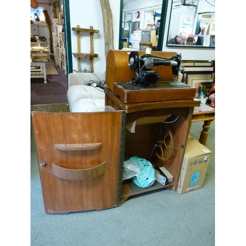 43 - Oak cased Singer Sewing machine and a Walnut cased sewing machine in case...