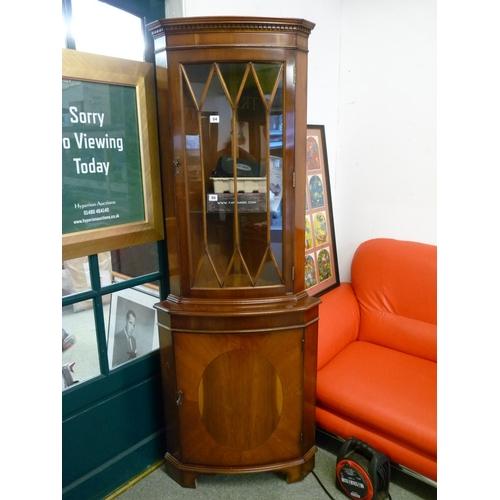 54 - Walnut glazed corner cabinet...