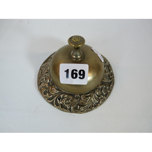 169 - Brass Edwardian Desk Bell with Foliate Silver embossed base, Birmingham 1905. Condition: some wear t...