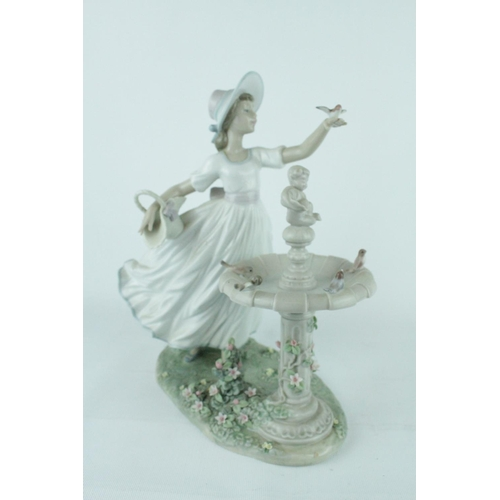 39 - Lladro 'Spring Joy' figurine, Sculptor: Regino Torrijos. Model 01006106, Introduced in 1994. 27cm in...