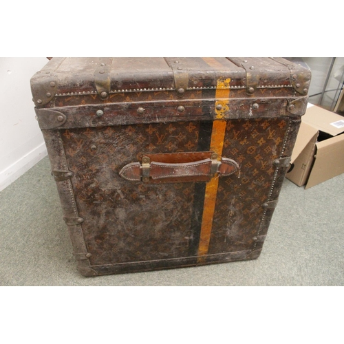 281 - VINTAGE LOUIS VUITTON STEAMER TRUNK an early 20thc steamer trunk, the monogrammed case with wooden b...