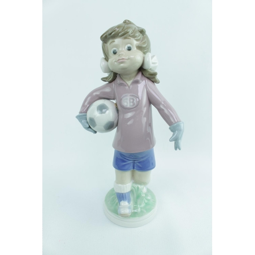 136 - Lladro 'Sports Lilly Football', Sculptor: Jose Roig, Model 01005134, Introduced in 1982 and Retired ...
