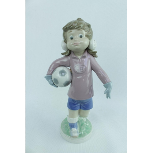 139 - Lladro 'Sports Lilly Football', Sculptor: Jose Roig, Model 01005134, Introduced in 1982 and Retired ...